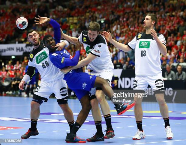 Finn Lemke of Germany challenges Dika Meme of France during the 26th IHF Men's World Championship 3rd place match between Germany and France at Jyske...