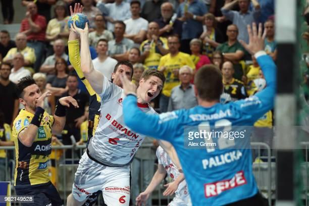 Finn Lemke of Melsungen scores a goal against goalkeeper Andreas Palicka of RheinNeckar Loewen during the DKB HBL match between RheinNeckar Loewen...