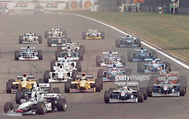Finn Mika Hakkinen on McLarenMercedes leads the pack ahead of teamate David Coulthard of Scotland and Canadian Jacques Villeneuve on WilliamsRenault...