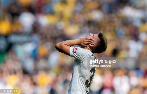 Finn Ole Becker of St Pauli reacts after the Second Bundesliga match between SG Dynamo Dresden and FC St Pauli at RudolfHarbigStadion on August 31...