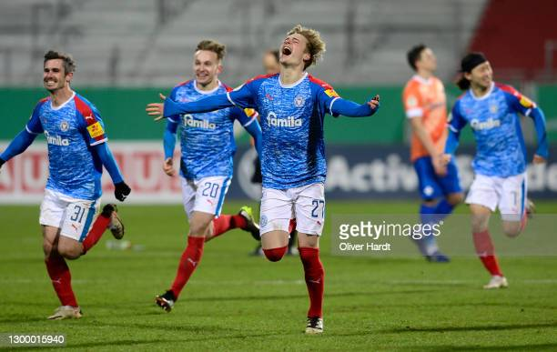 Finn Porath of Holstein Kiel celebrates after their side wins the penalty shoot out in the DFB Cup Round of Sixteen match between Holstein Kiel and...