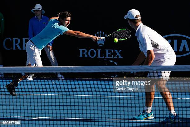 Finn Reynolds of New Zealand and Duarte Vale of Portugal compete against Ergi Kirkin of Turkey and Corentin Moutet of France during the Australian...