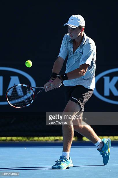 Finn Reynolds of New Zealand conmpetes in his first round match against Matteo Martineau of France during the Australian Open 2017 Junior...