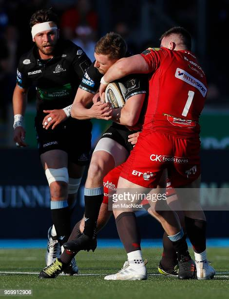Finn Russell of Glasgow Warriors is tackled by Rob Evans of Scarlets during the Guinness Pro14 Semi Final match between Glasgow Warriors and Scarlets...