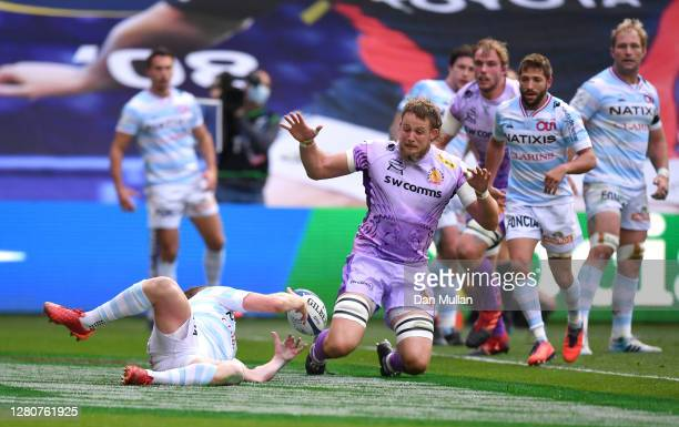 Finn Russell of Racing 92 drops the ball on his line as Jonny Hill of Exeter Chiefs attempts to ground it during the Heineken Champions Cup Final...