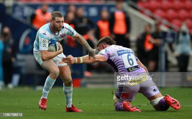 Finn Russell of Racing 92 gets past Dave Ewers of Exeter Chiefs during the Heineken Champions Cup Final match between Exeter Chiefs and Racing 92 at...