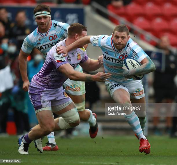 Finn Russell of Racing 92 goes past Sam Simmonds during the Heineken Champions Cup Final match between Exeter Chiefs and Racing 92 at Ashton Gate on...
