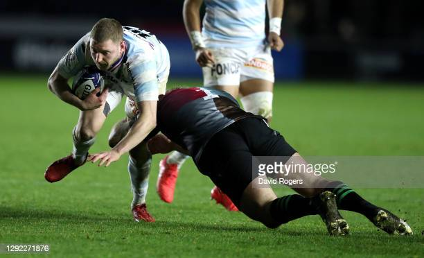 Finn Russell of Racing 92 is tackled by Joe Marler during the Heineken Champions Cup Pool 2 match between Harlequins and Racing 92 at Twickenham...