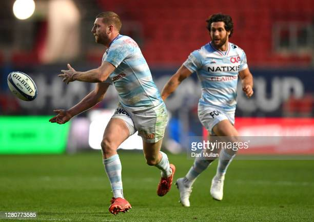 Finn Russell of Racing 92 offloads the ball during the Heineken Champions Cup Final match between Exeter Chiefs and Racing 92 at Ashton Gate on...