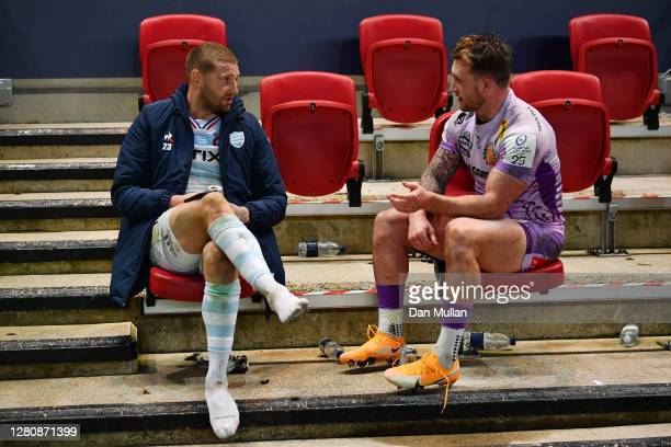 Finn Russell of Racing 92 shares a beer with Stuart Hogg of Exeter Chiefs following the Heineken Champions Cup Final between Exeter Chiefs and Racing...