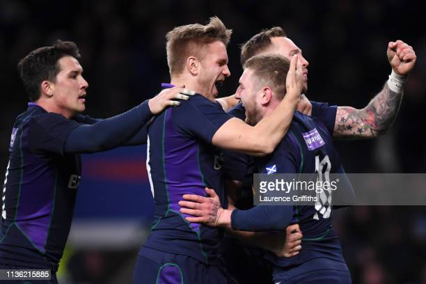 Finn Russell of Scotland celebrates with teammates after scoring Scotland's fifth try during the Guinness Six Nations match between England and...