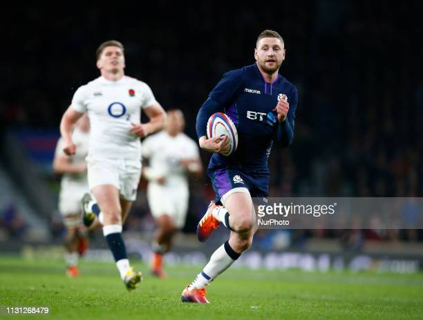 Finn Russell of Scotland going over for his Try during the Guinness 6 Nations Rugby match between England and Scotland at Twickenham stadium in...