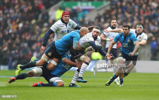 Finn Russell of Scotland is talked by Sergio Parisse of Italy during the RBS Six Nations Championship match between Scotland and Italy at Murrayfield...