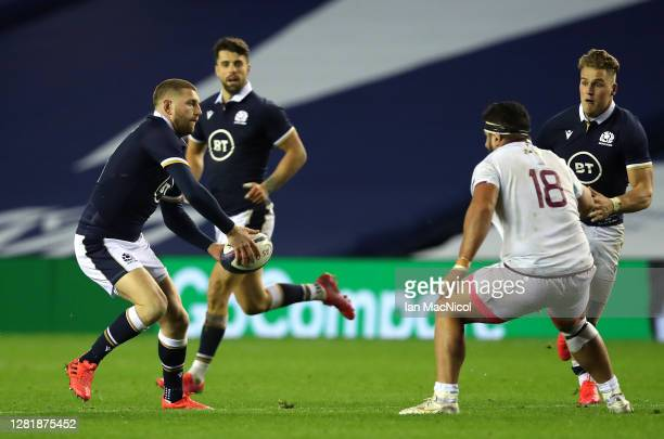 Finn Russell of Scotland offloads during the warm up match between Scotland and Georgia ahead of the Guinness Six Nations tournament at Murrayfield...