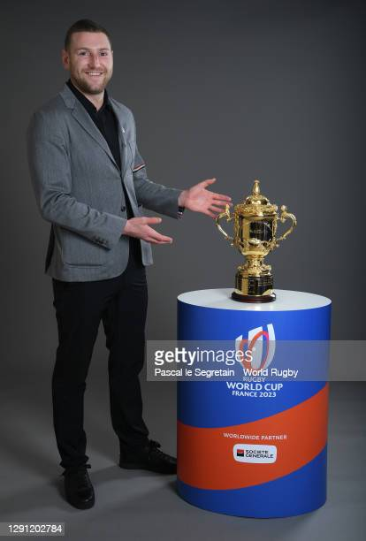 Finn Russell of Scotland poses with The Webb Ellis Cup prior to the Rugby World Cup France 2023 draw at Palais Brongniart on December 14, 2020 in...