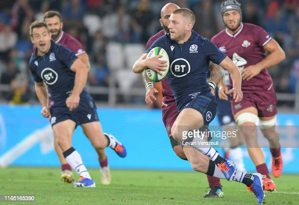 Finn Russell of Scotland runs with ball during the rugby international match between Georgia and Scotland at Dinamo Arena on August 31, 2019 in...