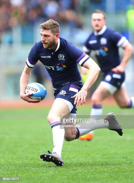 Finn Russell of Scotland runs with the ball during the NatWest Six Nations match between Italy and Scotland at Stadio Olimpico on March 17 2018 in...