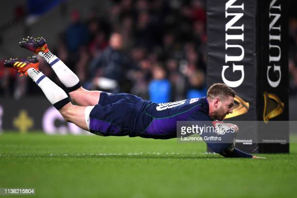 Finn Russell of Scotland scores his team's fifth try during the Guinness Six Nations match between England and Scotland at Twickenham Stadium on...