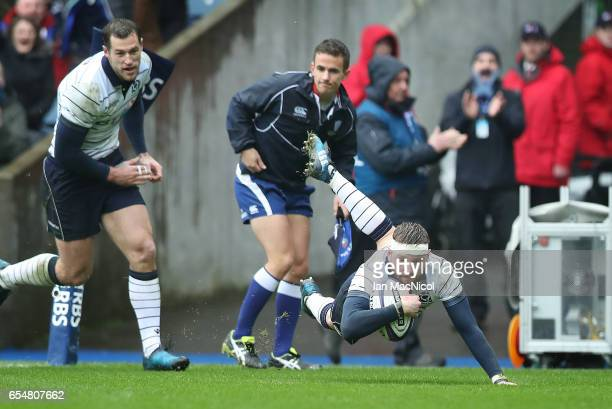 Finn Russell of Scotland scores the opening try during the RBS Six Nations Championship match between Scotland and Italy at Murrayfield Stadium on...