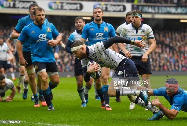 Finn Russell of Scotland splits the Italy defence to score the opening try during the RBS Six Nations match between Scotland and Italy at Murrayfield...