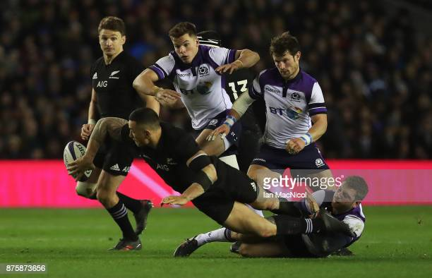 Finn Russell of Scotland tackles Sonny Bill Williams of New Zealand during the International test match between Scotland and New Zealand at...