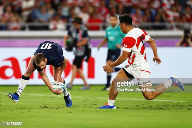 Finn Russell of Scotland touches down for their first try during the Rugby World Cup 2019 Group A game between Japan and Scotland at International...