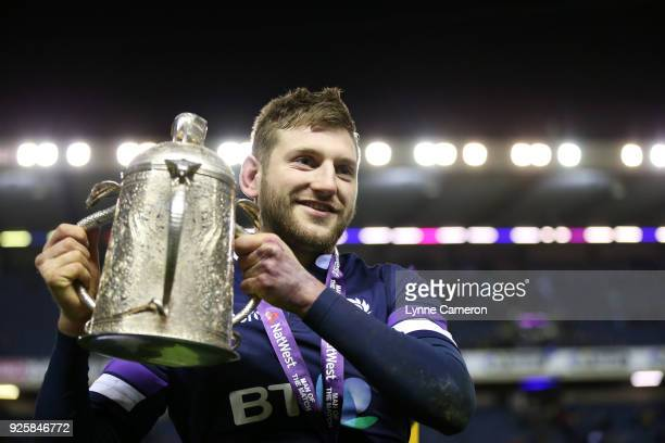 Finn Russell of Scotland with The Calcutta Cup after the NatWest Six Nations Championship between Scotland and England at Murrayfield on February 24...