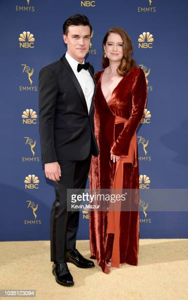 Finn Wittrock and Sarah Roberts attend the 70th Emmy Awards at Microsoft Theater on September 17 2018 in Los Angeles California