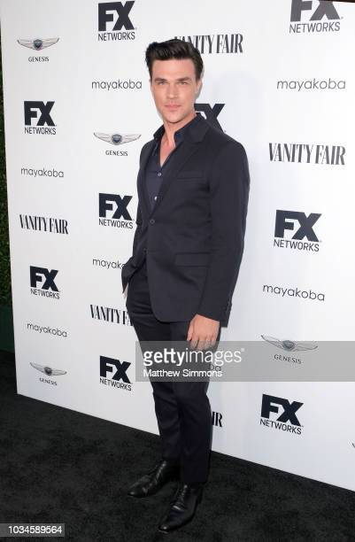Finn Wittrock attends the FX And Vanity Fair Emmy Celebration at CRAFT LA on September 16 2018 in Los Angeles California