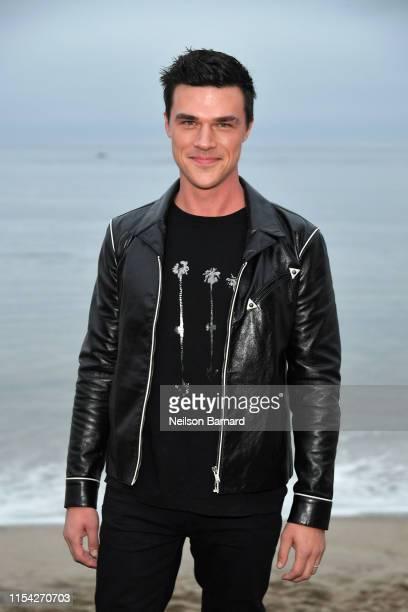 Finn Wittrock attends the Saint Laurent Mens Spring Summer 20 Show on June 06 2019 in Paradise Cove Malibu California