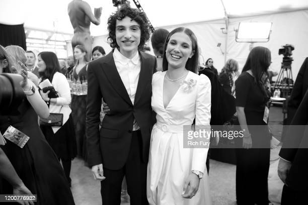 Finn Wolfhard and Millie Bobby Brown attend the 26th Annual Screen Actors Guild Awards at The Shrine Auditorium on January 19 2020 in Los Angeles...