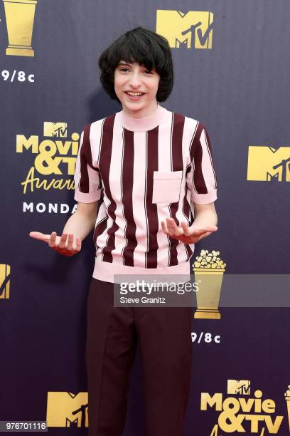 Finn Wolfhard attends the 2018 MTV Movie And TV Awards at Barker Hangar on June 16 2018 in Santa Monica California
