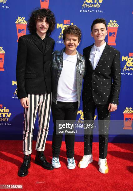 Finn Wolfhard Gaten Matarazzo and Noah Schnapp attend the 2019 MTV Movie and TV Awards at Barker Hangar on June 15 2019 in Santa Monica California