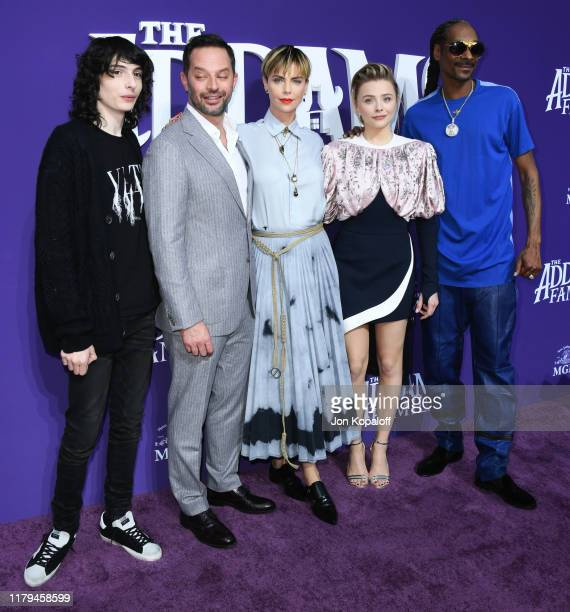 """Finn Wolfhard, Nick Kroll, Charlize Theron, Chloë Grace Moretz and Snoop Dogg attend the premiere of MGM's """"The Addams Family"""" at Westfield Century..."""