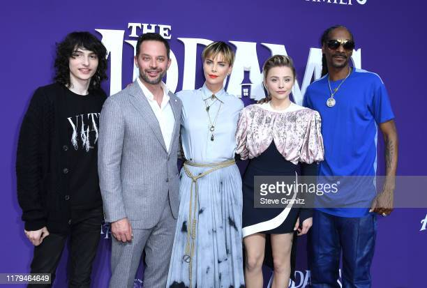 """Finn Wolfhard, Nick Kroll, Charlize Theron, Chloë Grace Moretz and Snoop Dogg arrives at the Premiere Of MGM's """"The Addams Family"""" at Westfield..."""