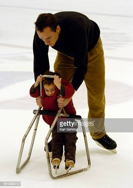DAD Finneas Gordon age 2 used a training device to help him with his balance as he took to the ice for the very first time at the Joy Burns Skating...