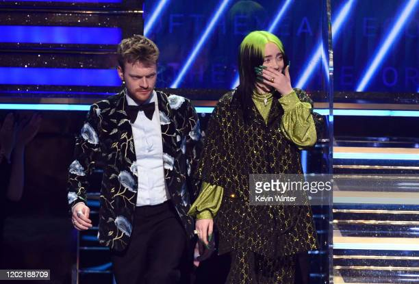 Finneas O'Connell and Billie Eilish accept the Album of the Year award for 'When We All Fall Asleep Where Do We Go' onstage during the 62nd Annual...