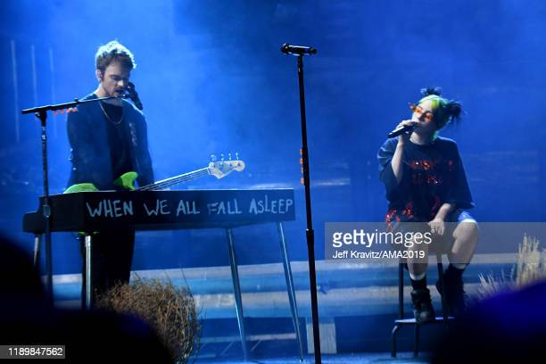 Finneas O'Connell and Billie Eilish perform onstage during the 2019 American Music Awards at Microsoft Theater on November 24 2019 in Los Angeles...