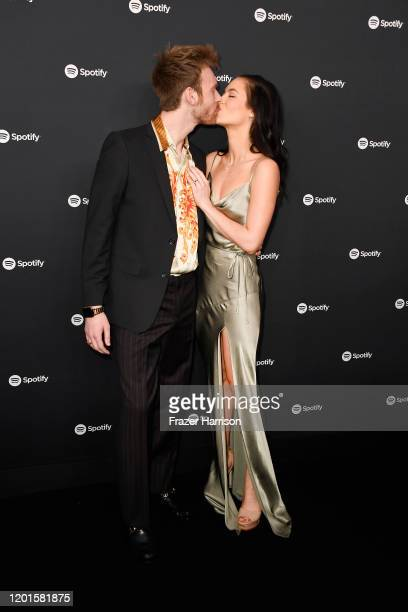 Finneas O'Connell and Claudia Sulewski attend Spotify Hosts Best New Artist Party at The Lot Studios on January 23 2020 in Los Angeles California