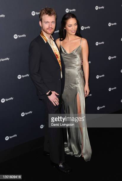 Finneas O'Connell and Claudia Sulewski attend the Spotify Best New Artist 2020 Party at The Lot Studios on January 23 2020 in Los Angeles California