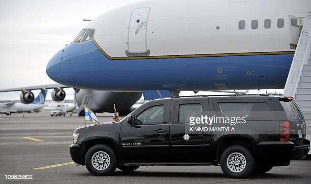 Finnegan Biden granddaugther of US Vice President Joe Biden takes some pictures from a car after their arrival at HelsinkiVantaa airport on March 7...