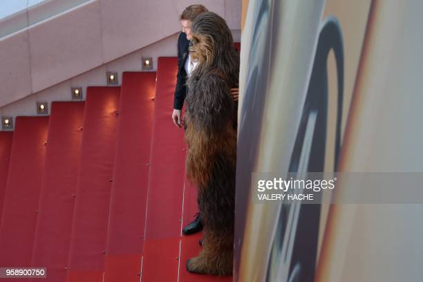 Finnish actor Joonas Suotamo and Chewbacca pose as they arrive on May 15 2018 for the screening of the film Solo A Star Wars Story at the 71st...