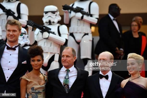Finnish actor Joonas Suotamo British actress Thandie Newton US actor Woody Harrelson US director Ron Howard and British actress Emilia Clarke pose as...