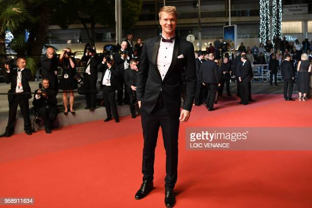 "Finnish actor Joonas Suotamo poses as he leaves the Festival Palace on May 15, 2018 after the screening of the film ""Solo : A Star Wars Story"" at the..."