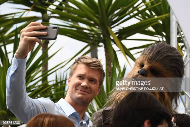 "Finnish actor Joonas Suotamo who plays Chewbacca poses on May 15, 2018 with Chewbacca during a photocall for the film ""Solo : A Star Wars Story"" at..."