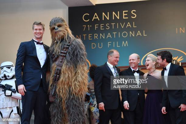 Finnish actor Joonas Suotamo who plays Chewbacca poses with Chewbacca as they arrive on May 15, 2018 with US actor Woody Harrelson, US director Ron...