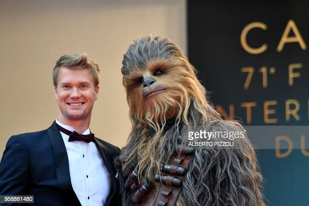 "Finnish actor Joonas Suotamo who plays Chewbacca poses with Chewbacca as they arrive on May 15, 2018 for the screening of the film ""Solo : A Star..."