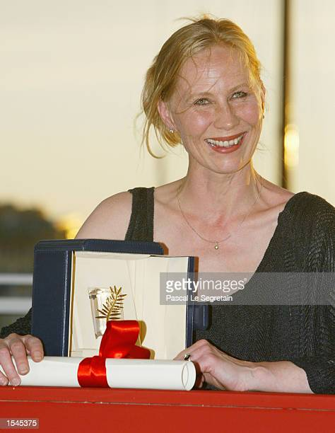 Finnish actress Kati Outinen holds her Best Actress award for the film 'The Man Withhout a Past' at the 55th Cannes Film Festival May 26 2002 in...