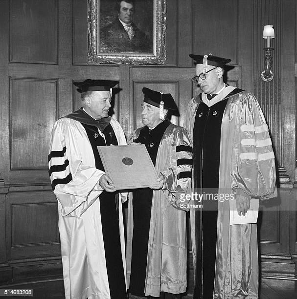 Finnish architect Alvar Aalto receives an honorary degree from Dr Grayson Kirk President of Columbia University Standing next to them is Kenneth...
