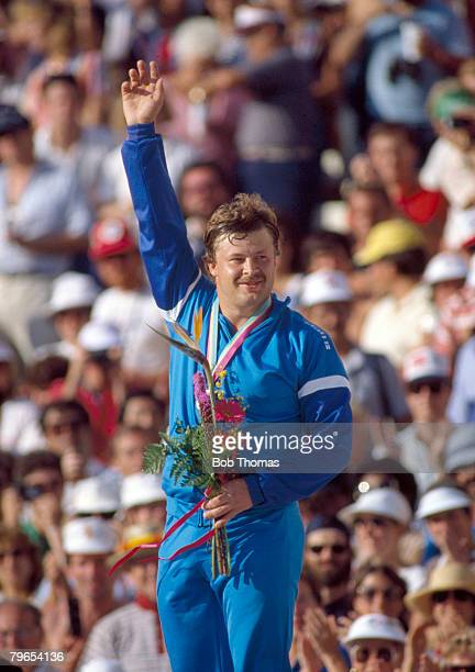 Finnish athlete Juha Tiainen celebrates on the medal winners podium after being awarded the gold medal after winning the Men's hammer throw event...